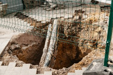 large pit in the city during the repair