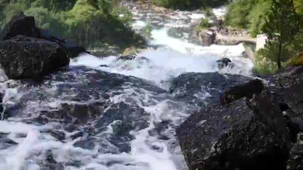 Waterfall at mountain river in summer
