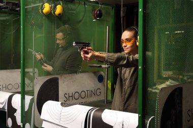 The woman aiming a gun at a target stock vector