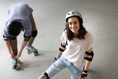 Play on roller skates.