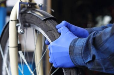 Replacing a tire in a bicycle.