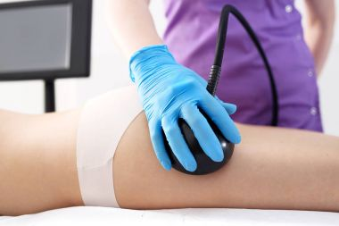 Cellulite reduction treatment, woman in the beauty salon.