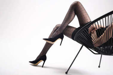 Black tights, beautiful female legs.Sensual female legs in black stockings.