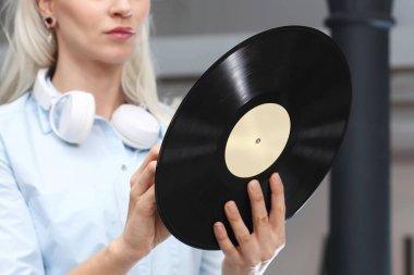 vinyl record,  Young stylish woman holding a vinyl record.