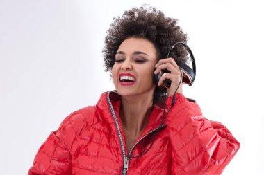 Female dj posing in red.