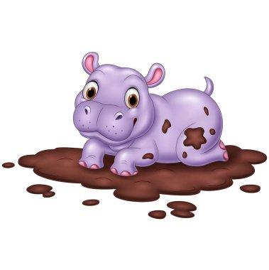 Cute hippo in the mud