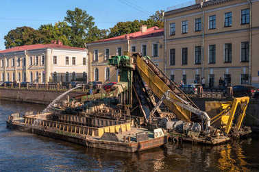 St. Petersburg, Russia - September 24, 2017: Work to deepen the bottom in the channel of the urban river Moika.