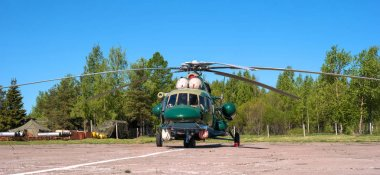 Multipurpose helicopter Mi-8 MT at the airfield in Pushkin during the festive Airshow.