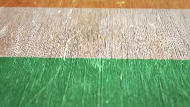 Flag Of Cote dIvoire. Detail On Wood, Shallow Depth Of Field, Seamless Loop. High-Quality Animation. Ideal For Your Country / Travel / Political Related Projects. 1080p, 60fps.