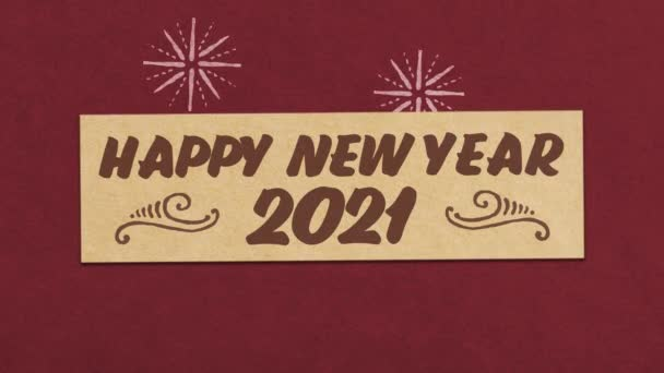 frohes neues Jahr 2021 Grußkarte auf rotem Papier strukturierten Hintergrund. ideal für Ihr Silvester-Projekt. nahtlose 4k-Animation in hoher Qualität