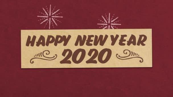 Šťastný Nový rok 2020 přání na červeném papíře texturované pozadí. Ideální pro váš nový rok / Silvestr Související projekt. Bezešvé vysoce kvalitní 4k animace