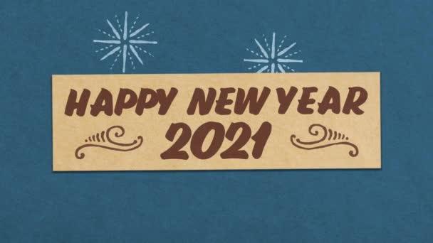 frohes neues Jahr 2021 Grußkarte auf blauem Papier strukturierten Hintergrund. ideal für Ihr Silvester-Projekt. nahtlose 4k-Animation in hoher Qualität
