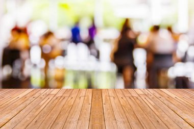 Old wooden table with blur coffee shop background, empty tabletop ready for product advertising