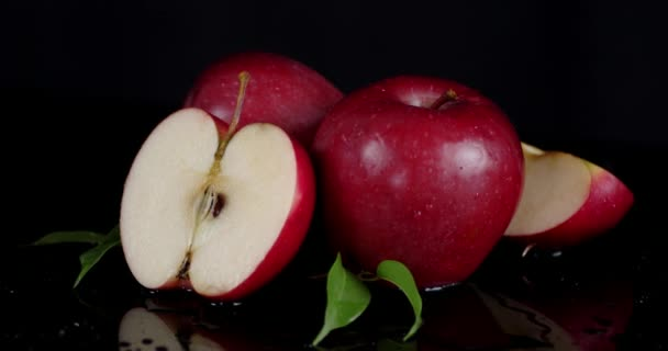 Fresh red apples with leaves .