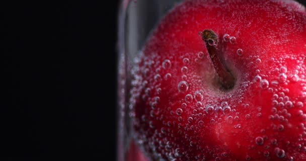 Fresh red Apple in water.