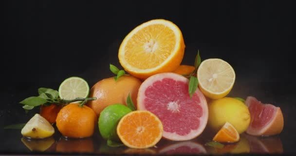 A variety of sliced citrus fruits with a cool steam.