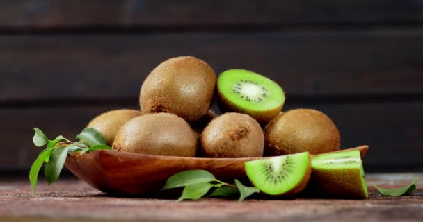 Aromatic ripe kiwi with leaves on a plate to slowly rotate.