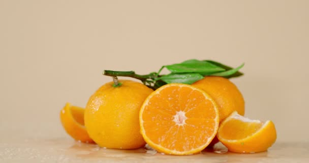 Slices and whole tangerines on the table slowly rotates.