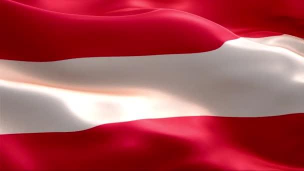 Osztrák zászló lengett a szélben. 4K Nagy felbontású Full HD. Looping Video of International Flag of Austria nemzetközi lobogó.