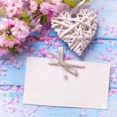 sakura flowers and decorative heart