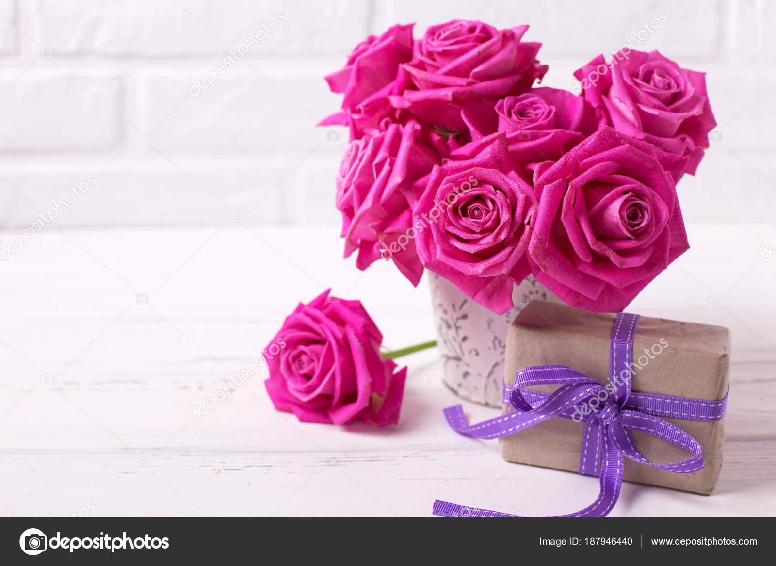 Bright pink roses flowers pot box present white wooden background bright pink roses flowers in pot and box with present on white wooden background selective focus place for text photo by daffodil mightylinksfo Choice Image