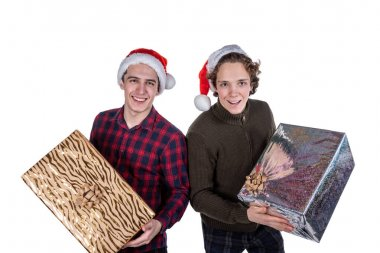 Two funny young men celebrating christmas isolated over white background