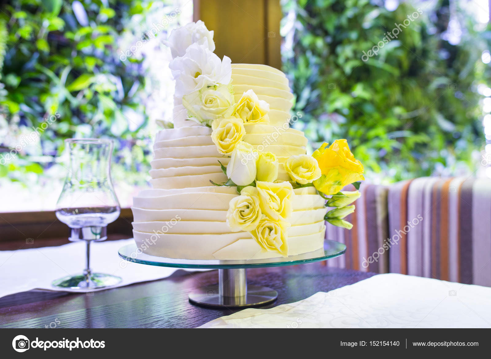 Bride\'s cake with and yellow green flowers. — Stock Photo © ANITAsan ...