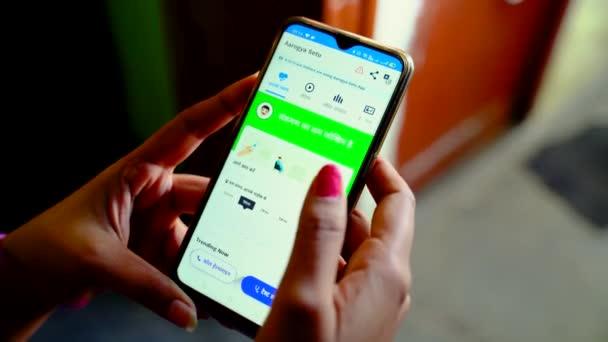 Browsing statistics on Aarogya Setu app on a mobile phone under home quarantine.