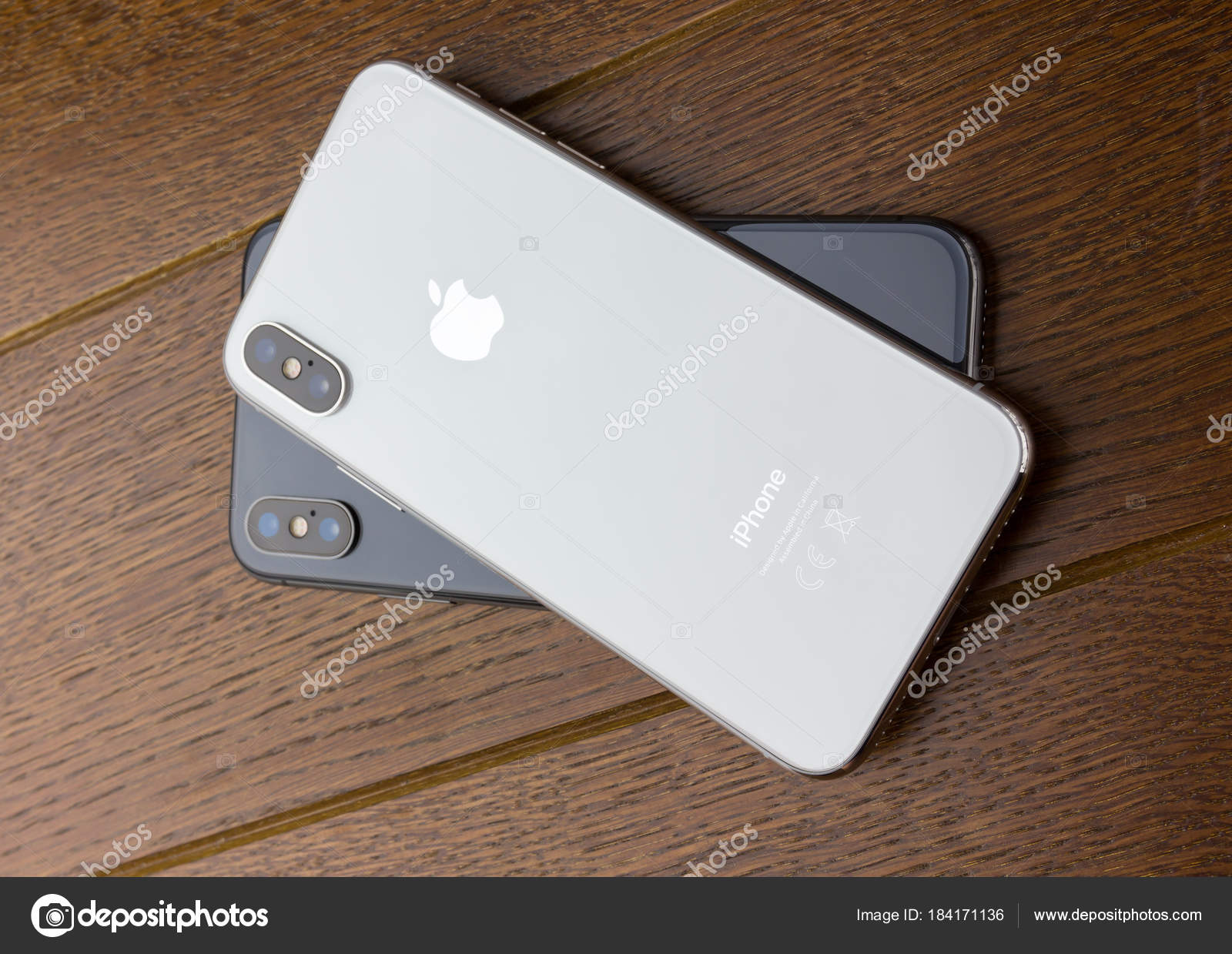 February 2018 Two Iphone X Lies On A Wooden Table Stock Editorial