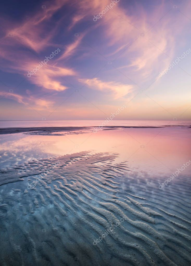 Sand on the seashore during sunset.