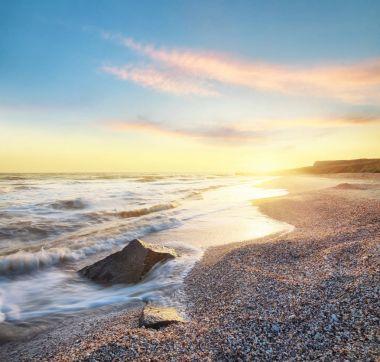 Sea shore during sunrise