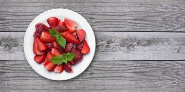 Juicy strawberries on old wood background