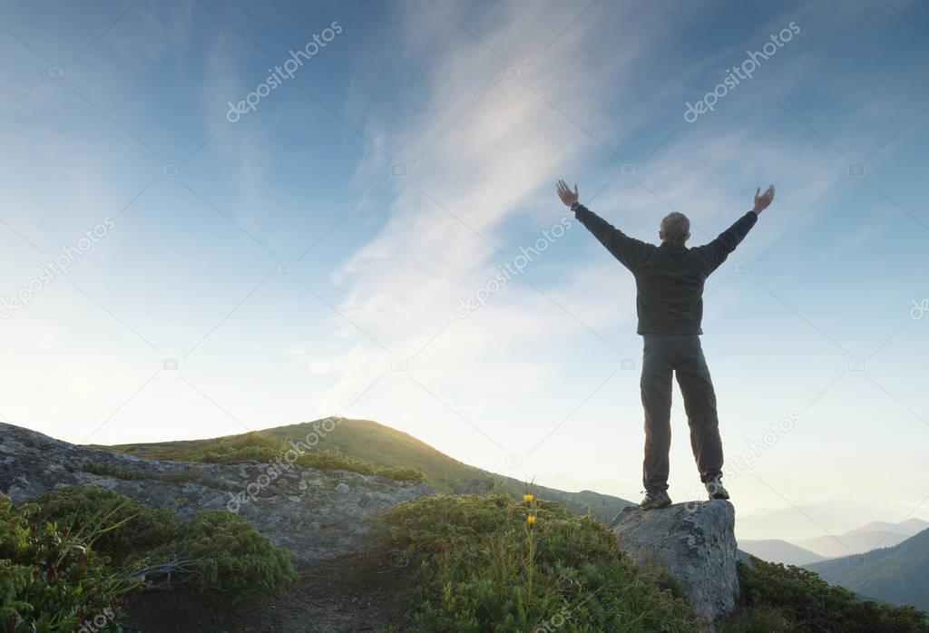 Silhouette of a winner on mountain top. Sport and active life concep