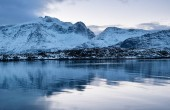 Mountains ridge and reflection on the water surface. Natural landscape in the Norway