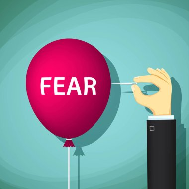 Man bursts a balloon with the word fear.