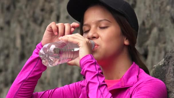 Thirsty Girl Drinking Bottled Water
