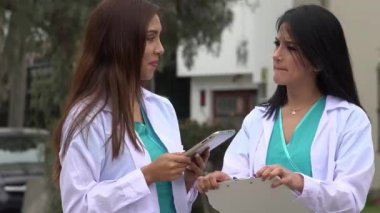 Female Nurses Or Doctors Talking