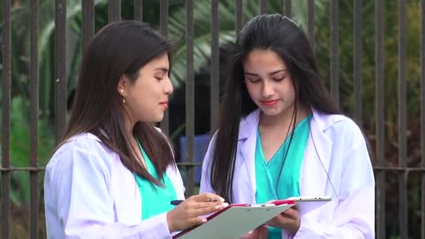 Young Female Doctors Or Nurses