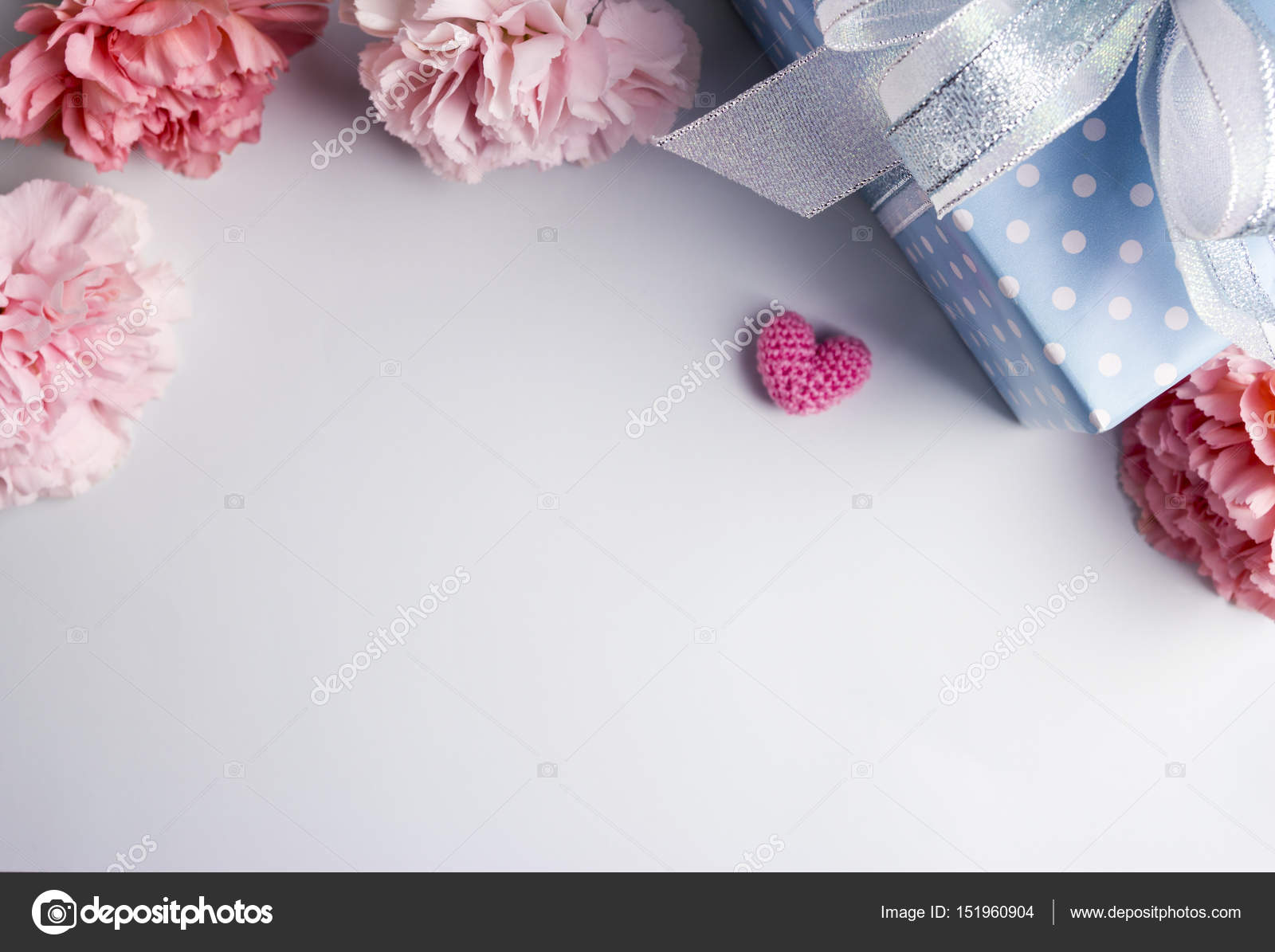 Happy mothers day concept of pink carnation flowers and gift box and ...
