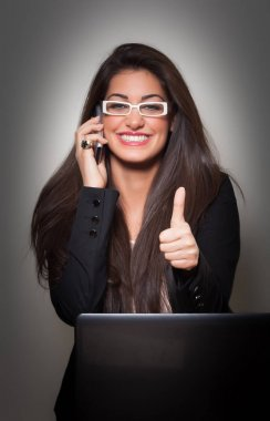 Successful Smiling Young  Businesswoman wearing white glasses