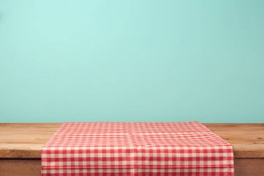 table and red checked tablecloth