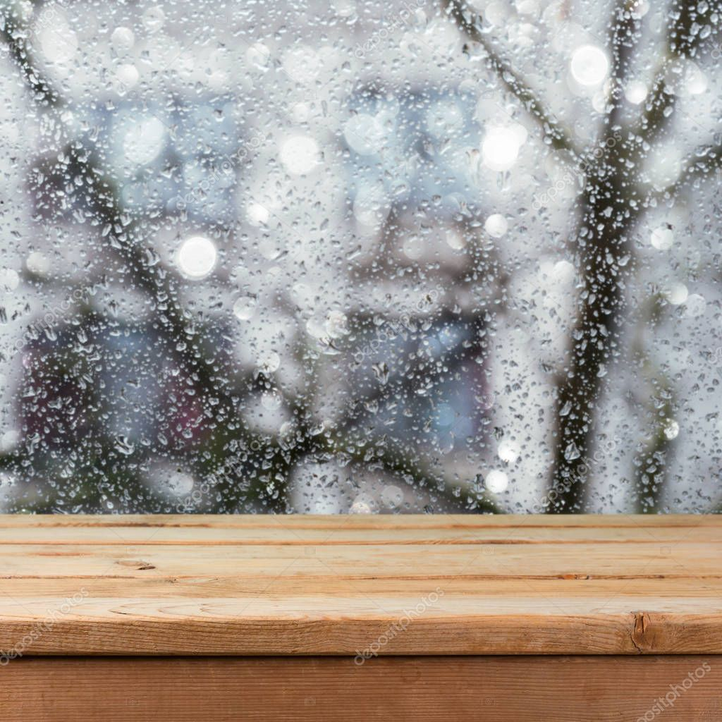 table over wet glass window