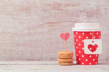 coffee cup and macarons.