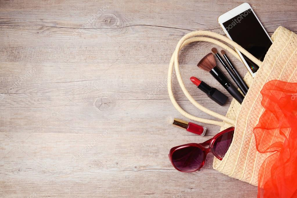 Bag with makeup and fashion objects