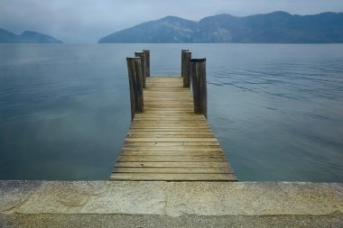 Wooden pier on lake.