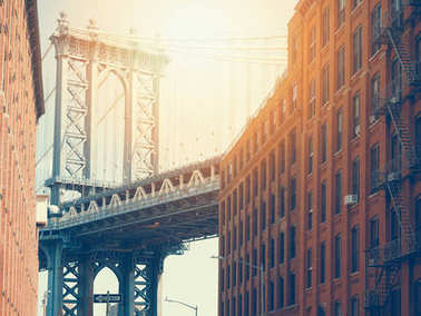Manhattan bridge and a brick buildings