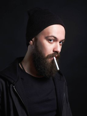 handsome bearded smoking man in Hat
