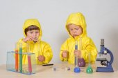 Photo Children play chemists game at home
