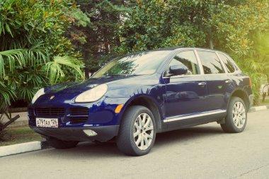 Porsche Cayenne parked on the street.
