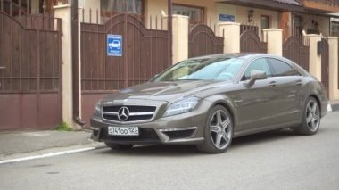 New luxury Mercedes-Benz AMG parked near the house.